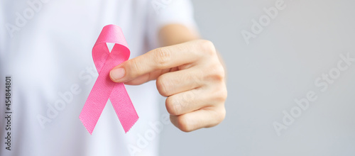 Fotografering October Breast Cancer Awareness month, elderly Woman in white T- shirt with hand holding Pink Ribbon for supporting people living and illness