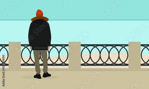 Canvastavla A male character in a jacket and a hat stands on the embankment and looks at the