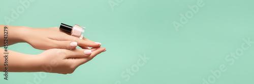 Fotografija Female hands with pink nail design