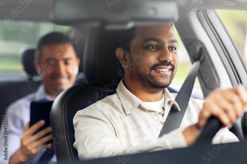 Obraz na plátně transportation, vehicle and people concept - happy smiling indian male driver dr