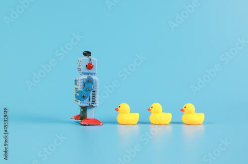 Fototapeta vintage retro robot and Yellow Rubber Bath Ducks, leadership concept