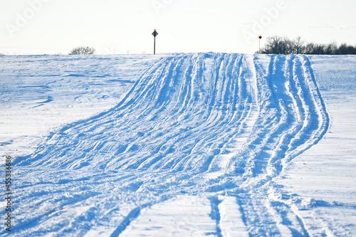 Snowmobile Tracks on the Hill Fototapet