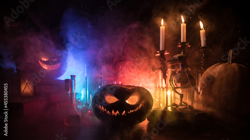 Valokuva Halloween still-life background with different elements on dark toned foggy background
