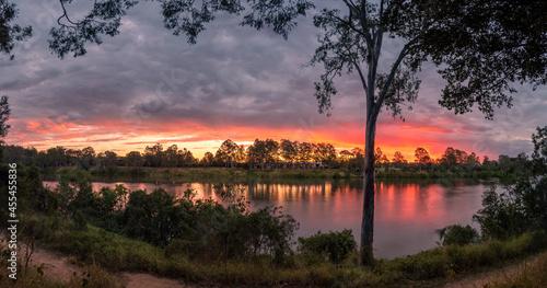 Stampa su Tela Beautiful Panoramic Riverside Sunset with Cloud Reflections