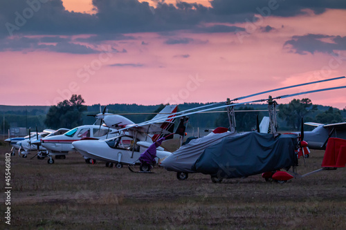 Tela Shrouded gyroplanes and small private aircrafts at the airfield in the evening l