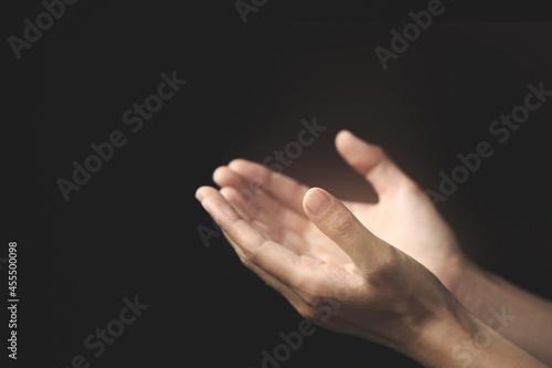 Fotografia Human hands open palm up worship,  Pray for god blessing.