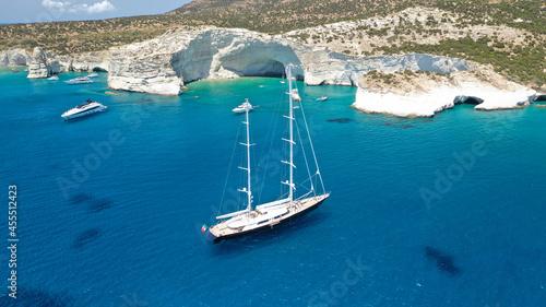 Slika na platnu Aerial drone photo of sail boat anchored in Kleftiko - iconic beautiful scenic w