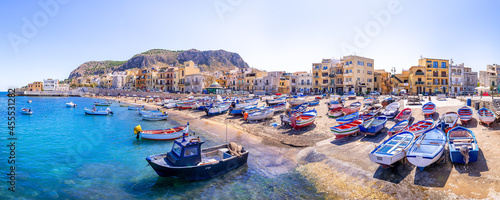 Fotografiet colorful fishing boats at the port of aspra, sicily
