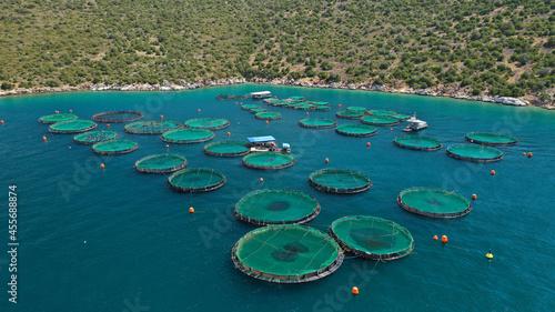Valokuva Aerial drone photo of latest technology auto feeding fish farming  - breeding un
