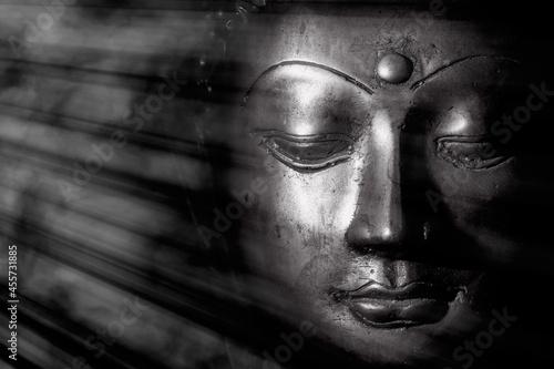 Murais de parede Mindful monochrome buddha face with mystical heavenly light