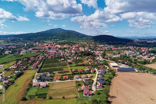 Fotografie, Obraz Mountain village with forests, bird eye view