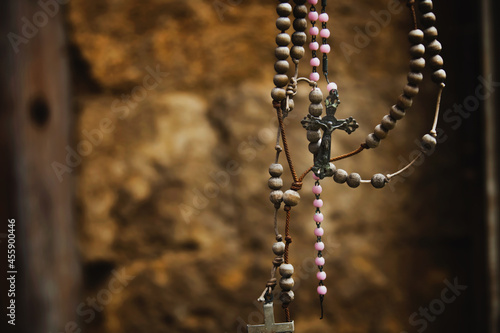 Carta da parati Old rosary against ancient ruins of church as a symbol of salvation and eternal life of human soul