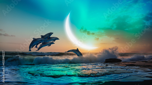 Fotografiet Group of dolphins jumping up from the sea at sunset with crescent moon and auror