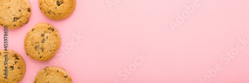 Fotografie, Obraz Dry cookies with chocolate pieces on light pink table background