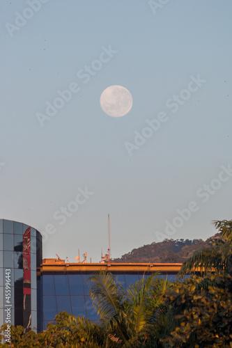 Canvas Print full moon over a building on Botafogo beach in Rio de Janeiro, Brazil
