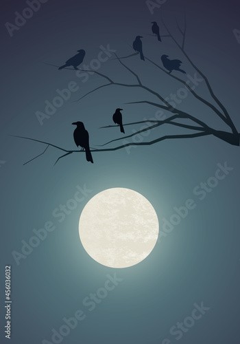 Fototapeta premium Silhouettes of crows on tree branches and the full moon in the background.