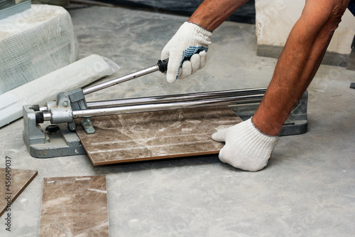 Canvas Cutting porcelain stoneware with a tile cutter.
