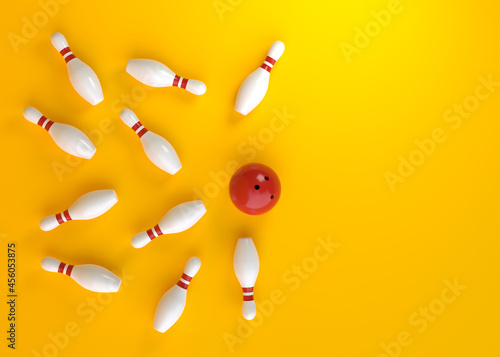 Fotomural Bowling ball hits all the skittles on yellow background