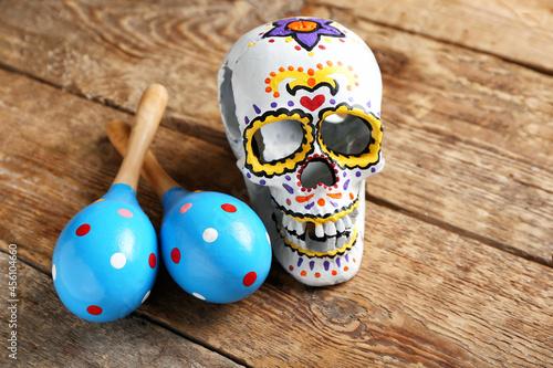Canvastavla Painted human skull for Mexico's Day of the Dead (El Dia de Muertos) and maracas