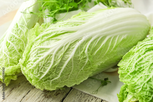 Fresh chinese cabbage on light wooden background, closeup Fotobehang