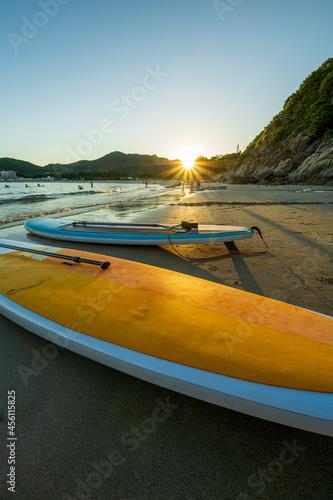 Obraz na plátně sampans on beach in sunset