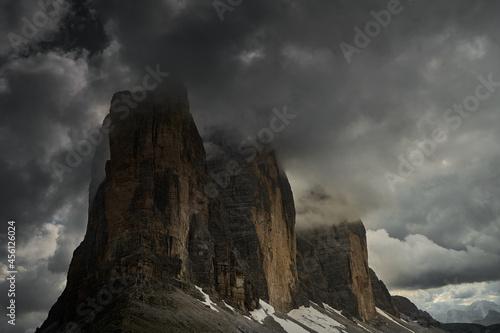 Fototapeta Scenic view of rocky cliffs enveloped in fog