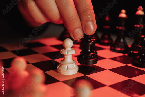 Fototapeta Businessman with chess board game. Plan stratgy concept