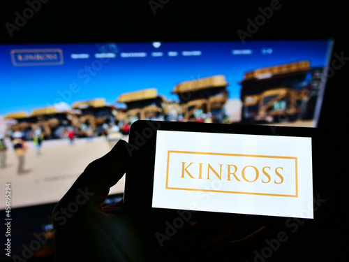 Fototapeta premium STUTTGART, GERMANY - Mar 05, 2021: Person holding smartphone with logo of Kinross Gold Corporation on screen in front of website.