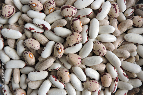 Colourful beans infested and destroyed by weevils, beans with round circles unde Fototapeta