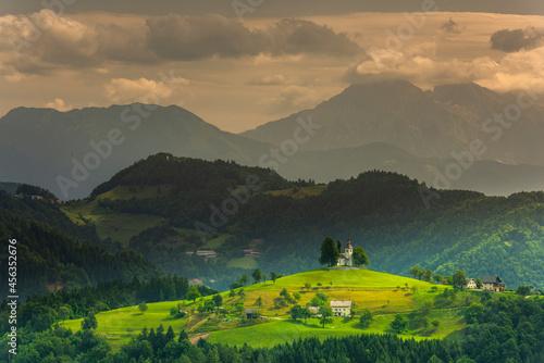 Obraz na plátně Landmark Church Stand Out at Hilltop in Julian Alps Landscape