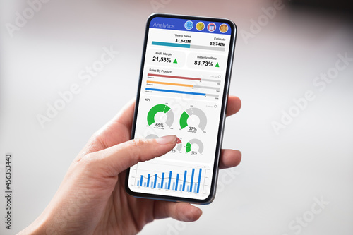 Hands Holding Cell Phone With Blank Screen
