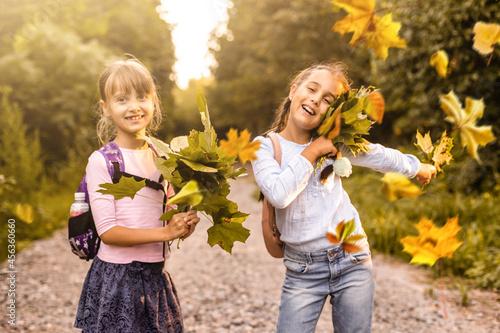 Stampa su Tela schoolgirls among the autumn landscape.