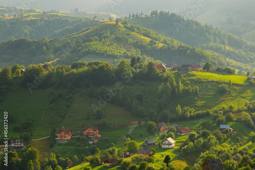 Fotografiet Houses and farms on the hillside in Magura village in Romania