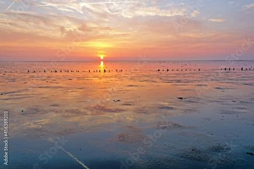 Fototapeta Sunset at the Wadden Sea in the Netherlands