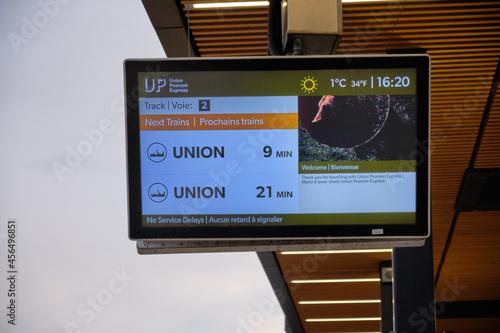 Fototapeta premium TORONTO, CANADA - Jan 07, 2020: Up Express train announcement board on its way to downtown Toronto in Ontario, Canada