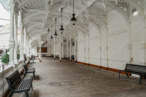 Fotografie, Obraz Carved wooden Market Colonnade,Trzni kolonada, with three mineral springs in historical centre of Karlovy Vary,Czech Republic