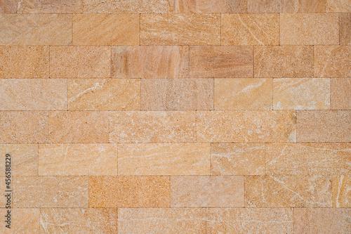 Beige block wall texture background. Abstract exterior rock stone pattern bricks design stack.