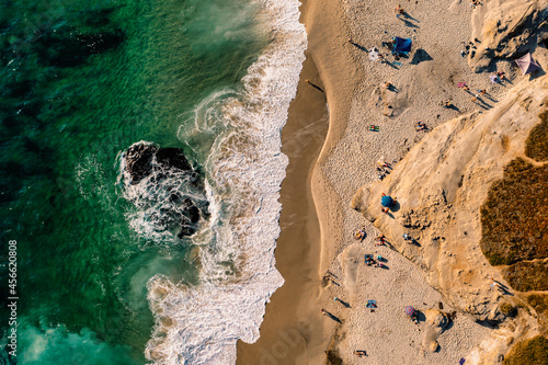 Fotografie, Obraz Drone birds eye view of people and umbrellas on beach