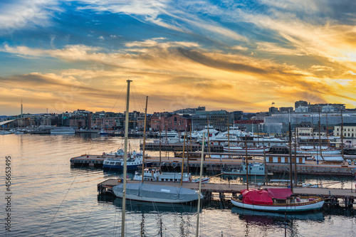 Fotografiet Oslo Norway, sunset city skyline at harbour