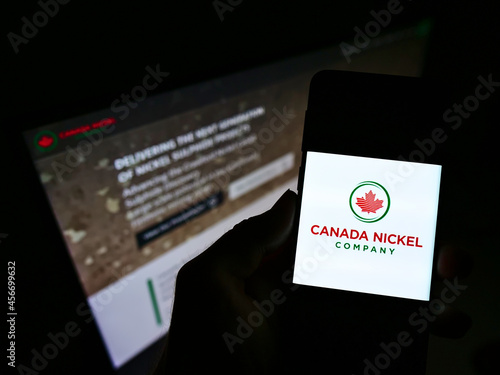 Fototapeta premium STUTTGART, GERMANY - Feb 16, 2021: Person holding smartphone with logo of Canada Nickel Company Inc. on screen in front of website.