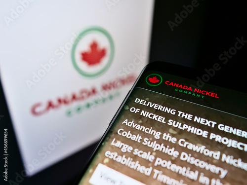 Fototapeta premium STUTTGART, GERMANY - Feb 16, 2021: Smartphone with website of mining business Canada Nickel Company Inc. on screen in front of logo.