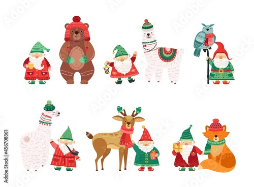 Fototapeta premium Holiday winter characters. Christmas dwarfs with animals in knit hats and scarves. Isolated scandi cartoon man with white beard vector set