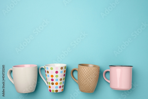 Fotografering stack of empty ceramic cup on a blue background, flat lay