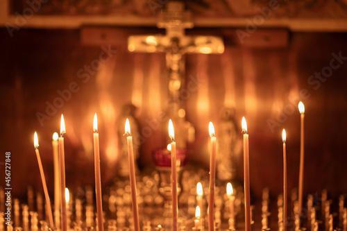 christian church, wax candles burn before the crucifixion of Jesus Christ, faith Fototapet