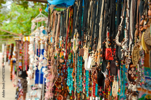 Fotografie, Obraz Street market, stall of necklaces and handmade jewelry in an open-air market