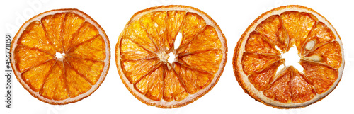 Fotografering Dried orange slices on an isolated white background.
