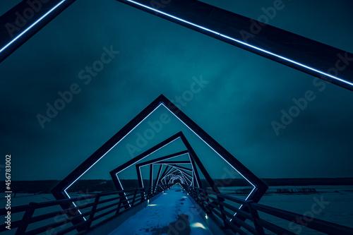 Wallpaper Mural Modern geometric neon bridge architecture at night on walkway, High Trestle Trail Bridge