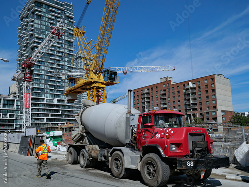 Fototapeta premium Toronto, Canada - September 13, 2021: A cement truck delivers material for the construction of a new downtown condominium apartment building.