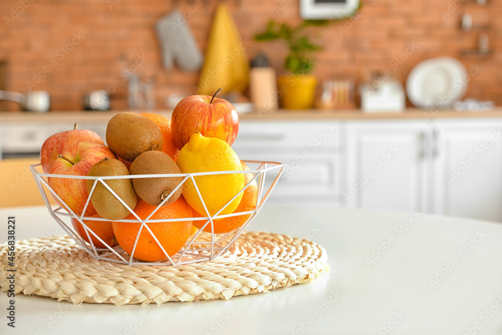 Leinwandbild Motiv - Pixel-Shot : Basket with tropical fruits on table in kitchen