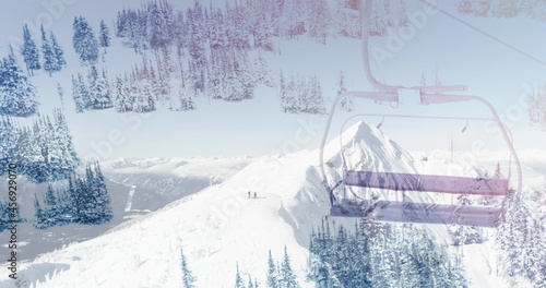 Image of winter scenery with ski chair lift and mountains